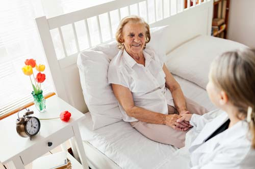 carer providing care for elderly woman in her home