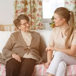 senior-sitting-with-her-nurse-P285ZHA