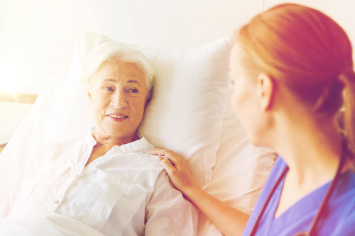 carer in conversation with woman at home